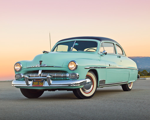 AUT 21 RK3202 01 © Kimball Stock 1950 Mercury Monterey Seafoam 3/4 Front View On Pavement At Dusk