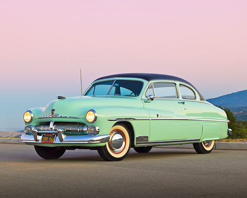 AUT 21 RK3203 01 © Kimball Stock 1950 Mercury Monterey Seafoam 3/4 Front View On Pavement At Dusk