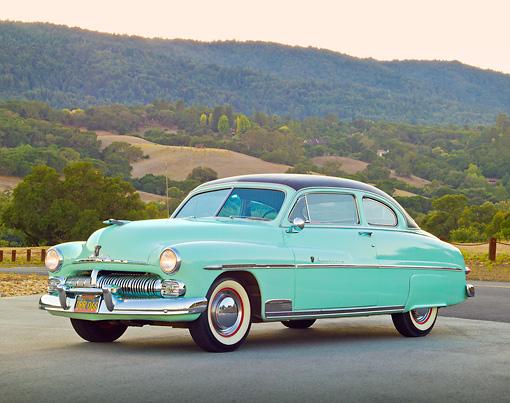 AUT 21 RK3204 01 © Kimball Stock 1950 Mercury Monterey Seafoam 3/4 Front View On Road By Hills