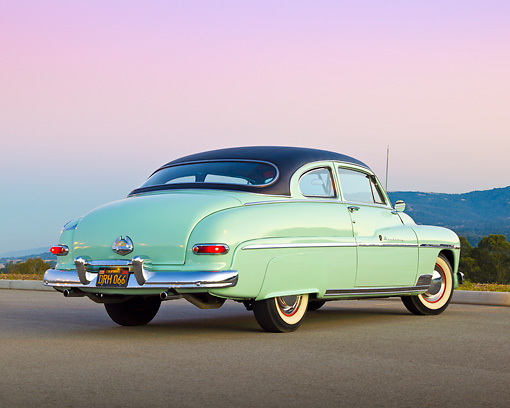 AUT 21 RK3205 01 © Kimball Stock 1950 Mercury Monterey Seafoam 3/4 Rear View On Pavement At Dusk