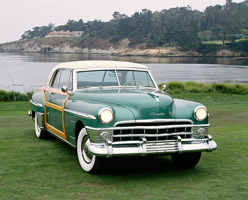 AUT 21 RK3220 01 © Kimball Stock 1950 Chrysler Town & Country Green 3/4 Front View On Grass By Water