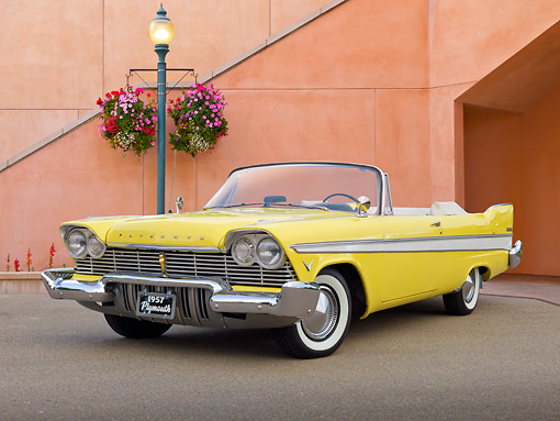 AUT 21 RK3232 01 © Kimball Stock 1957 Plymouth Belvedere Convertible Canary Yellow 3/4 Front View On Pavement By Building And Lamp Post