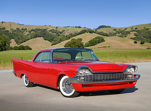 AUT 21 RK3239 01 © Kimball Stock 1958 Chrysler Windsor Red 3/4 Front View On Pavement By Grassy Hills