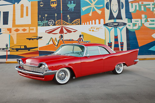 AUT 21 RK3242 01 © Kimball Stock 1958 Chrysler Windsor Red 3/4 Front View On Pavement By Mural