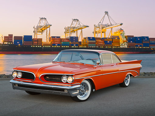 AUT 21 RK3245 01 © Kimball Stock 1959 Pontiac Bonneville Orange 3/4 Front View On Pavement By Shipping Harbor At Dusk