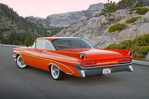 AUT 21 RK3248 01 © Kimball Stock 1959 Pontiac Bonneville Orange 3/4 Rear View On Pavement In Mountains