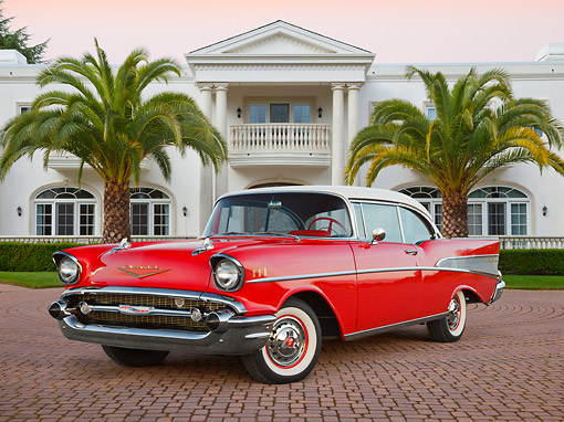 AUT 21 RK3257 01 © Kimball Stock 1957 Chevrolet Bel Air Red With White Top 3/4 Front View On Brick By Mansion