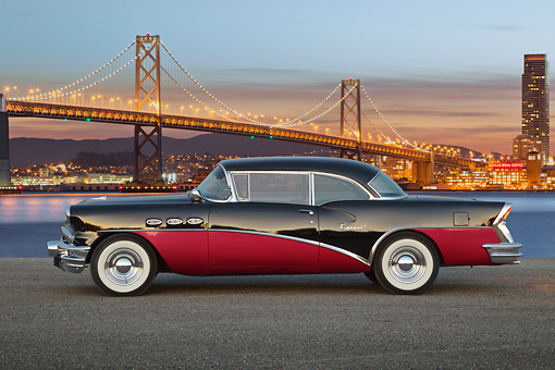 AUT 21 RK3272 01 © Kimball Stock 1956 Buick Special Black And Fuschia Profile View On Pavement By Bay Bridge At Night