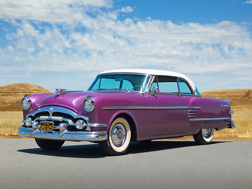 AUT 21 RK3273 01 © Kimball Stock 1954 Packard Pacific Purple 3/4 Front View On Pavement By Dry Grass