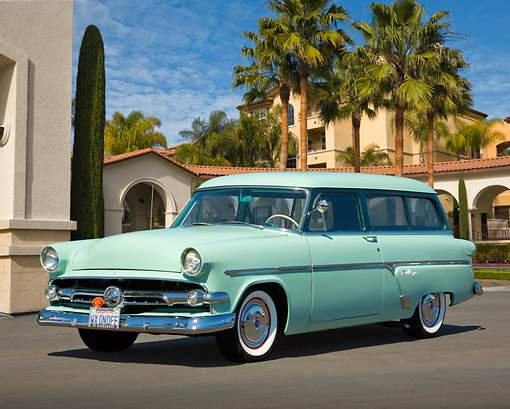 AUT 21 RK3290 01 © Kimball Stock 1954 Ford Ranch Wagon Sea Foam Green 3/4 Front View On Pavement By Buildings