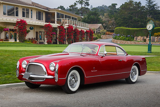 AUT 21 RK3292 01 © Kimball Stock 1953 Chrysler Ghia Red 3/4 Front View On Pavement By Building