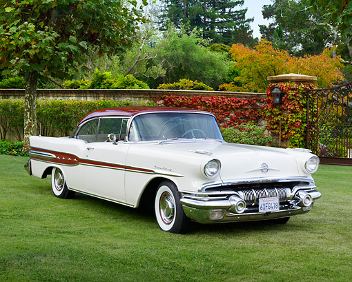AUT 21 RK3297 01 © Kimball Stock 1957 Pontiac Star Chief White And Red 3/4 Front View On Grass By Trees And Gate