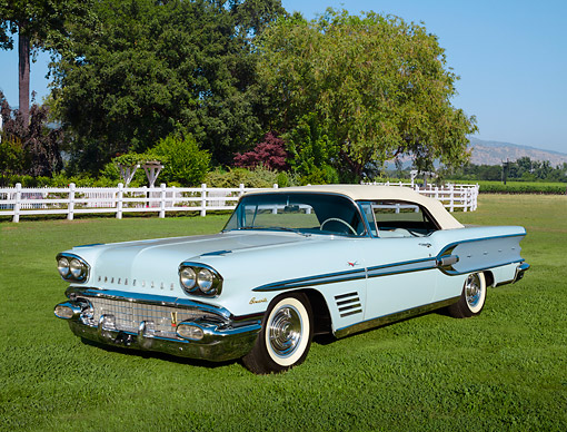 AUT 21 RK3299 01 © Kimball Stock 1958 Pontiac Bonneville Two-Tone Blue 3/4 Front View On Grass By Trees And White Fence