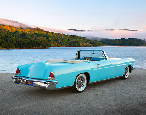 AUT 21 RK3302 01 © Kimball Stock 1956 Lincoln Continental Mark 22 Light Blue 3/4 Rear View On Pavement By Lake