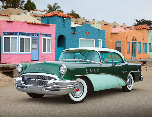 AUT 21 RK3306 01 © Kimball Stock 1956 Buick Century Two-Tone Green 3/4 Front View On Pavement By Colorful Houses