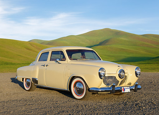 AUT 21 RK3311 01 © Kimball Stock 1951 Studebaker Champion Yellow 3/4 Front View On Gravel By Grassy Hills
