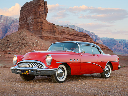 AUT 21 RK3319 01 © Kimball Stock 1954 Buick Super Red And Black 3/4 Front View On Gravel By Red Rock