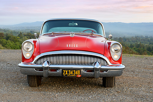 AUT 21 RK3321 01 © Kimball Stock 1954 Buick Super Red And Black Front View On Gravel In Hills At Dusk
