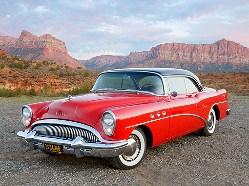 AUT 21 RK3322 01 © Kimball Stock 1954 Buick Super Red And Black 3/4 Front View On Gravel By Red Rock