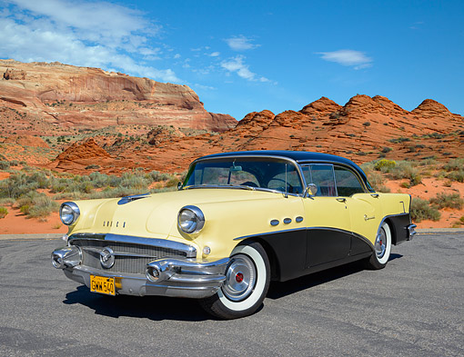AUT 21 RK3328 01 © Kimball Stock 1956 Buick Special Yellow And Black 3/4 Front View On Pavement By Red Rock
