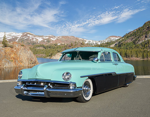 AUT 21 RK3330 01 © Kimball Stock 1951 Lincoln Green And Black 3/4 Front View On Pavement By Water And Mountains