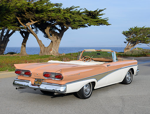 AUT 21 RK3351 01 © Kimball Stock 1958 Ford Fairlane Skyliner Convertible Salmon And Cream 3/4 Rear View On Pavement By Trees And Water