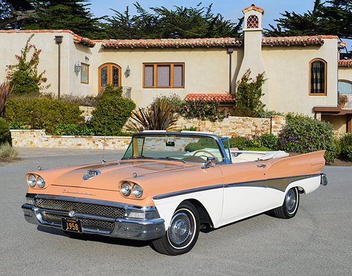 AUT 21 RK3352 01 © Kimball Stock 1958 Ford Fairlane Skyliner Convertible Salmon And Cream 3/4 Front View On Pavement By House