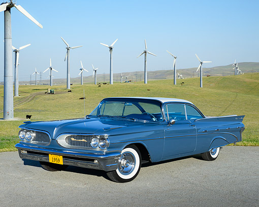 AUT 21 RK3355 01 © Kimball Stock 1959 Pontiac Bonneville Arctic Blue 3/4 Front View On Pavement By Windmills