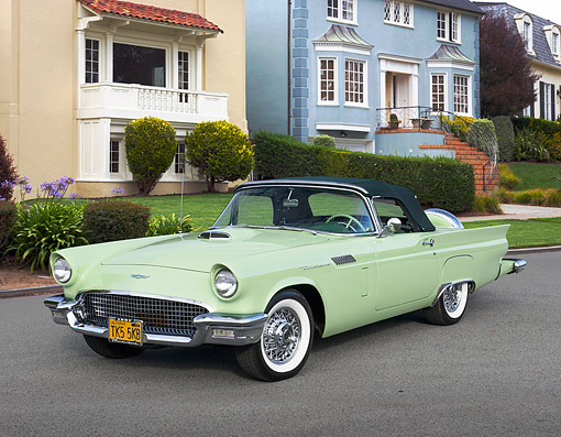 AUT 21 RK3356 01 © Kimball Stock 1957 Ford Thunderbird Willow Green 3/4 Front View On Pavement By Houses
