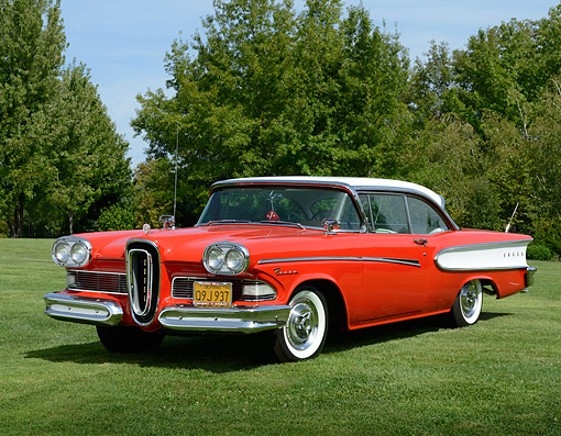 AUT 21 RK3362 01 © Kimball Stock 1958 Edsel Pacer Hardtop Convertible Red And White 3/4 Front View On Grass By Trees
