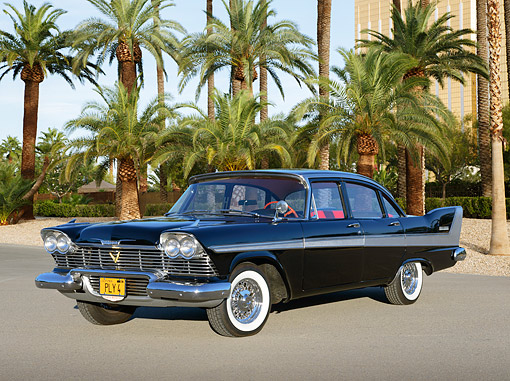 AUT 21 RK3367 01 © Kimball Stock 1958 Plymouth Fury Black 3/4 Front View On Pavement By Palm Trees