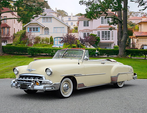 AUT 21 RK3370 01 © Kimball Stock 1951 Chevrolet Convertible Cream 3/4 Front View On Pavement By Houses