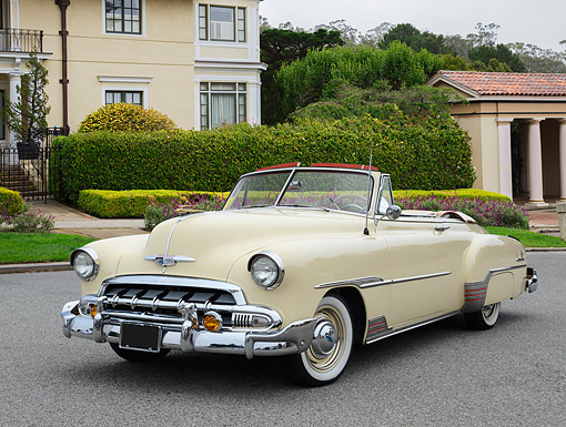AUT 21 RK3371 01 © Kimball Stock 1951 Chevrolet Convertible Cream 3/4 Front View On Pavement By Houses