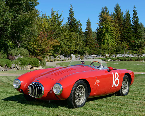 AUT 21 RK3380 01 © Kimball Stock 1955 OSCA MT4 Spider By Morelli Red 3/4 Front View On Grass By Trees