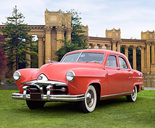 AUT 21 RK3383 01 © Kimball Stock 1951 Kaiser Frazer Vegabond Red 3/4 Front View On Grass By Palace Of Fine Arts