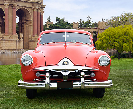 AUT 21 RK3384 01 © Kimball Stock 1951 Kaiser Frazer Vegabond Red Front View On Grass By Palace Of Fine Arts