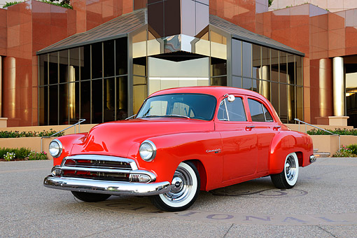 AUT 21 RK3387 01 © Kimball Stock 1951 Chevrolet Styleline Red 3/4 Front View On Pavement By Building