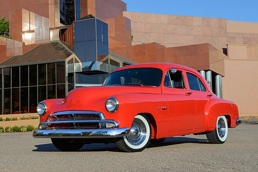 AUT 21 RK3388 01 © Kimball Stock 1951 Chevrolet Styleline Red 3/4 Front View On Pavement By Building