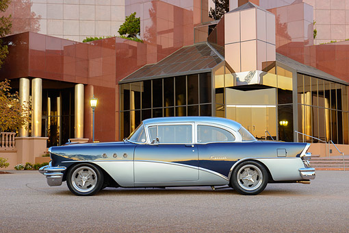 AUT 21 RK3391 01 © Kimball Stock 1955 Buick Special Blue And Silver Profile View On Pavement By Building