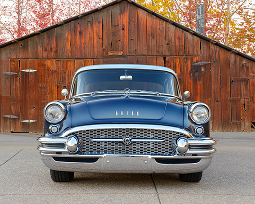 AUT 21 RK3392 01 © Kimball Stock 1955 Buick Special Blue And Silver Front View On Pavement By Barn