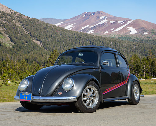 AUT 21 RK3400 01 © Kimball Stock 1957 Volkswagen Bug Oval Dark Charcoal Gray 3/4 Front View On Pavement By Mountains