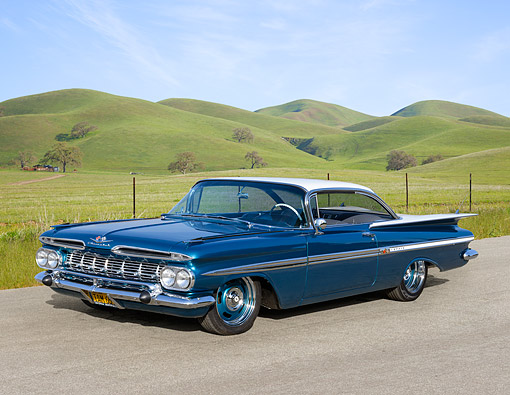 AUT 21 RK3402 01 © Kimball Stock 1959 Chevrolet Impala Teal And White 3/4 Front View On Pavement By Grassy Hills