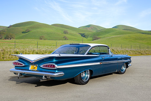 AUT 21 RK3403 01 © Kimball Stock 1959 Chevrolet Impala Teal And White 3/4 Rear View On Pavement By Grassy Hills
