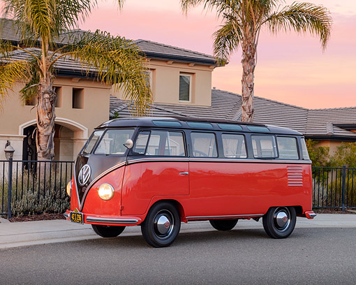 AUT 21 RK3417 01 © Kimball Stock 1954 Volkswagen Deluxe Microbus Red And Brown 3/4 Side View On Pavement By House At Dusk
