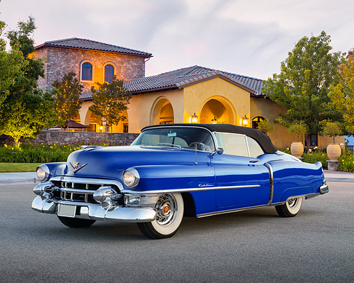 AUT 21 RK3421 01 © Kimball Stock 1953 Cadillac Eldorado Convertible Blue 3/4 Side View On Pavement By Building