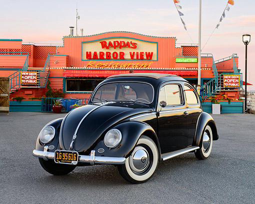 AUT 21 RK3423 01 © Kimball Stock 1953 Volkswagen Bug Black 3/4 Front View On Pavement By Restaurant