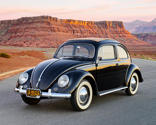 AUT 21 RK3424 01 © Kimball Stock 1953 Volkswagen Bug Black 3/4 Front View On Pavement In Desert At Dusk