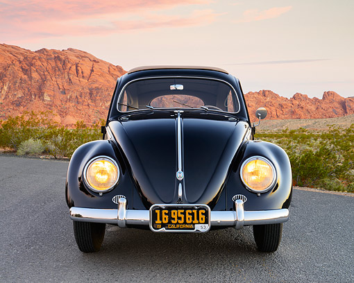 AUT 21 RK3425 01 © Kimball Stock 1953 Volkswagen Bug Black Front View On Pavement In Desert At Dusk