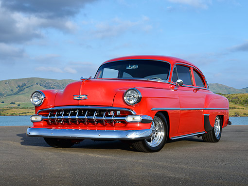 AUT 21 RK3426 01 © Kimball Stock 1954 Chevrolet 210 Red 3/4 Front View On Pavement By Water And Hills