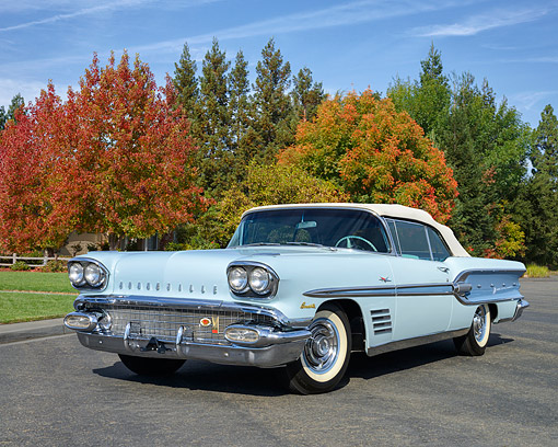 AUT 21 RK3428 01 © Kimball Stock 1958 Pontiac Bonneville 2-Tone Blue 3/4 Front View On Pavement By Autumn Trees